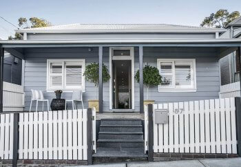 homefront-foliage-picket-fence-front-patio