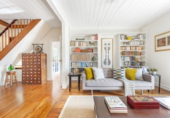 cottage-style-home-with-unique-furniture-and-a-colourful-bookshelf