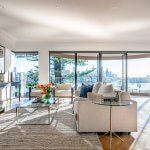 living-room-with-glass-coffee-table-and-beige-lounge