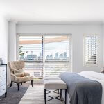 master-bedroom-with-ottoman-and-occasional-chair
