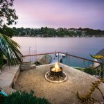 fire-pit-with-inbuilt-bench-seating-overlooking-the-water-at-oyster-bay