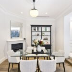a-glass-dining-table-with-upholstered-chairs-and-bookcase