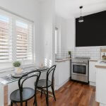 small-kitchen-with-table-and-stools-and-subway-tiles
