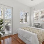 bedroom-with-floor-boards-shutters-and-lots-of-natural-light