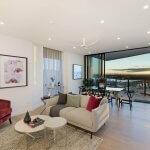 living-room-with-velvet-armchair-and-view-of-sydney